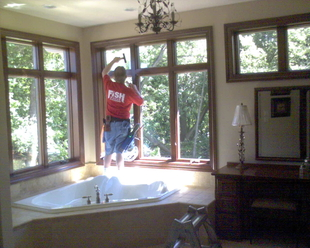 Residential Window Cleaning With A Squeegee