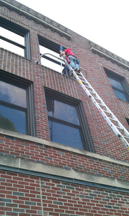 Cleaning Commercial Windows With A Ladder