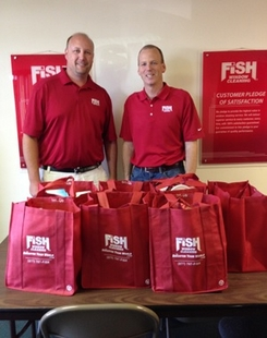 Dana Webber and Randy Cross with FISH Feeds Donations