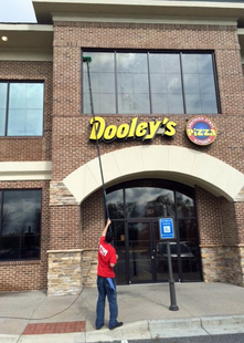 Cleaning Dooley's Windows With A Water-Fed Pole