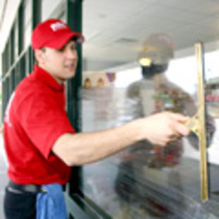 Cleaning exterior windows with a squeegee