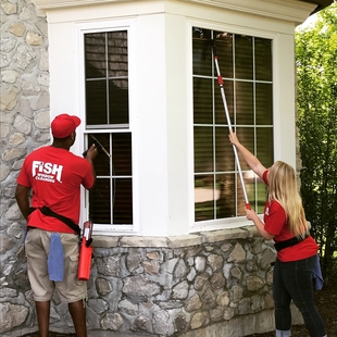 Two FISH Window Cleaners Cleaning Home Window
