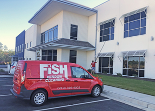 Fish Window Cleaning Van & Cleaner Cleaning Building