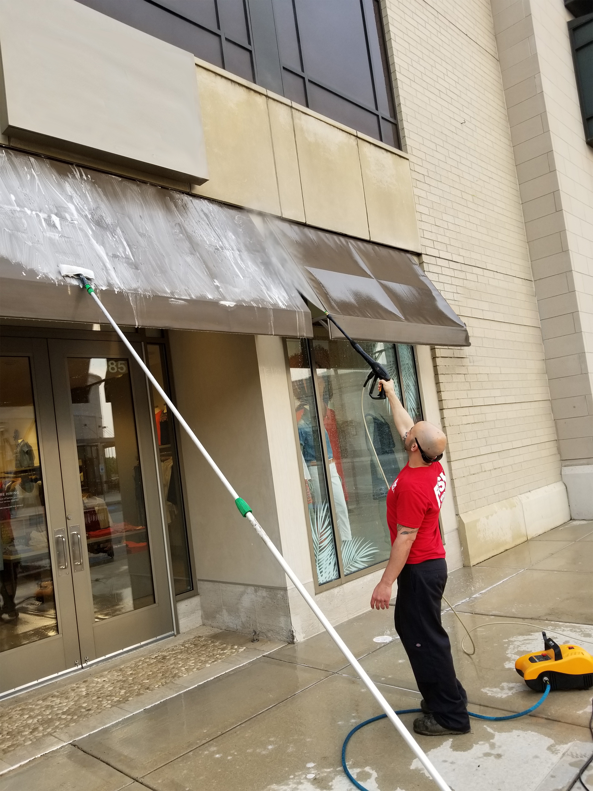 Two FISH Window Cleaners Clean Exterior Office Windows
